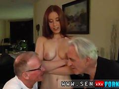 Young girl gratifies two elderly