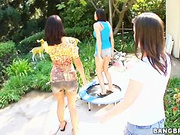 Three sexy girls play basketball in her backyard
